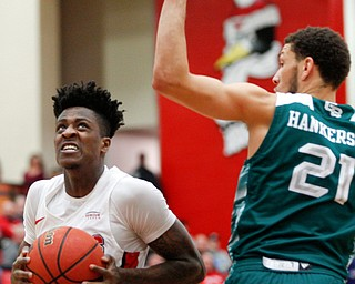 YSU's Donel Cathcart III looks to the hoop while Green Bay's Kameron Hankerson during their game in Beeghly Center on Saturday night. EMILY MATTHEWS | THE VINDICATOR