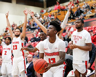 YSU's Donel Cathcart III looks toward the hoop while his teammates cheer for him during their game against Green Bay in Beeghly Center on Saturday night. EMILY MATTHEWS | THE VINDICATOR