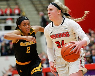 YSU's McKenah Peters drives the ball while Milwaukee's Akaylah Hayes runs after her during their game at Beeghly Center on Wednesday night. EMILY MATTHEWS | THE VINDICATOR