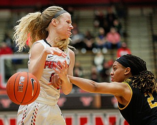 Milwaukee's Akaylah Hayes hits the ball out of the hands of YSU's Melinda Trimmer during their game at Beeghly Center on Wednesday night. EMILY MATTHEWS | THE VINDICATOR
