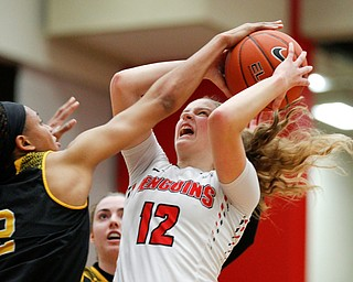 YSU's Chelsea Olson tries to shoot the ball while Milwaukee's Akaylah Hayes tries to block her during their game at Beeghly Center on Wednesday night. EMILY MATTHEWS | THE VINDICATOR