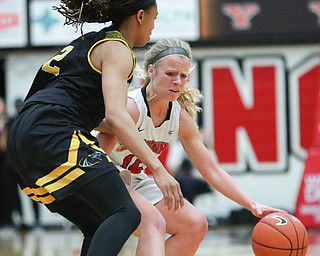 YSU's Melinda Trimmer drives the ball while Milwaukee's Akaylah Hayes tries to block her during their game at Beeghly Center on Wednesday night. EMILY MATTHEWS | THE VINDICATOR
