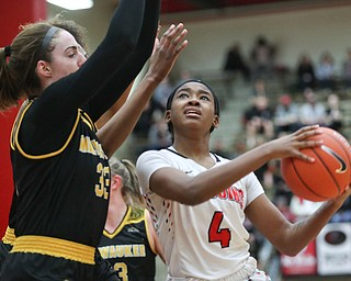 YSU's Deleah Gibson tries to shoot the ball while Milwaukee's Megan Walstad (33) and Ryaen Johnson try to block her during their game at Beeghly Center on Wednesday night. EMILY MATTHEWS | THE VINDICATOR