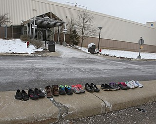 ROBERT K.YOSAY  | THE VINDICATOR..GM Lordstown finished the last Cruze at the plant Wed Afternoon. Putting thousands out of work ..some workers left their work shoes on the curb as they exited the plant