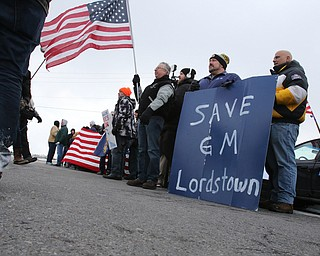 ROBERT K.YOSAY  | THE VINDICATOR..GM Lordstown finished the last Cruze at the plant Wed Afternoon. Putting thousands out of work ..workers protested and  block Bailey road with signs and flags