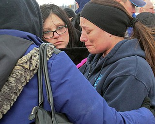 William D. Lewis the vindictor   Heidi Garren,right and a 24 year gm lordstown employee of Jefferson County  is comforted by fellow workers during a rally 3-6-19 outside the plant.