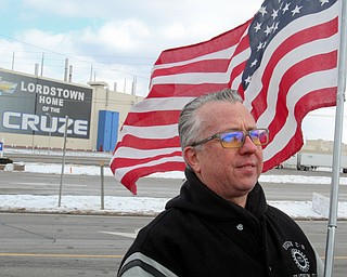William D. Lewis The Vindicator Mark Franko of Cortland anda 28 year employee ofGM Lordstown holds  flg outside the plant 3-6-19 after  the last Cruze rolled off the line.