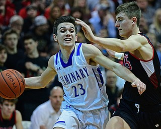 BOARDMAN, OHIO - MARCH 6, 2019: Poland's Michael Cougras drives on Canfield's Joe Bruno during the first half of their OHSAA Tournament game, Wednesday night at Boardman High School. DAVID DERMER | THE VINDICATOR
