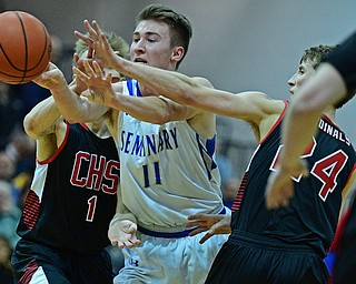 BOARDMAN, OHIO - MARCH 6, 2019: Poland's Collin Todd passes the ball while being pressured by Canfield's Kyle Gamble, right, and Aydin Hanousek during the second half of their OHSAA Tournament game, Wednesday night at Boardman High School. DAVID DERMER | THE VINDICATOR.