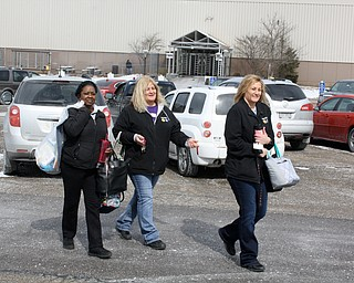 "These three GM Lordstown workers left the plant together at the end of their final shift Wednesday. They are, from left, Brenda Grooms and sisters Lisa Hines and Marcie Natal. ""We're down but don't count us out,"" Grooms said of her mood about the loss of her job."