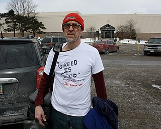"Doug Grant of Warren wore this t-shirt to work on his final day Wednesday that suggested that GM is greedy. He said the company confiscated the sign he brought with him. As for his future work, ""I don't know what I will do, probably reinvent myself,"" he said."