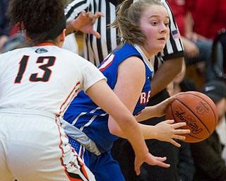 Western Reserve's Alyssa Serensky looks to pass the ball while Dalton's Jalyssa Turner tries to block her during their game at Perry High School in Massillon on Thursday evening. EMILY MATTHEWS | THE VINDICATOR