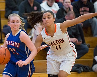 Western Reserve's Olivia Pater drives the ball while Dalton's Ellie Martinez tries to block her during their game at Perry High School in Massillon on Thursday evening. EMILY MATTHEWS | THE VINDICATOR