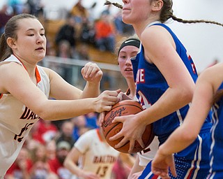 Western Reserve's Danni Vuletich looks to the hoop while Dalton's Tess Denning reaches for the ball during their game at Perry High School in Massillon on Thursday evening. EMILY MATTHEWS | THE VINDICATOR