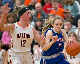 Western Reserve's Madison Owen drives the ball while Dalton's Emma Cannon tries to block her during their game at Perry High School in Massillon on Thursday evening. EMILY MATTHEWS | THE VINDICATOR