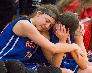 Western Reserve's Kennedy Miller, left, embraces Erica Dezee during the fourth period of their game against Dalton at Perry High School in Massillon on Thursday evening. Western Reserve lost 32-53. EMILY MATTHEWS | THE VINDICATOR