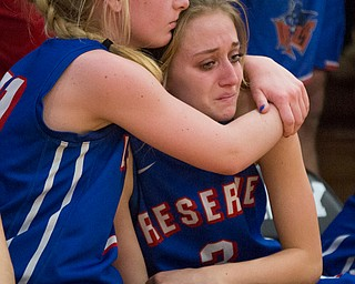 Western Reserve's Olivia Pater, left, embraces Madison Owen during the fourth period of their game against Dalton at Perry High School in Massillon on Thursday evening. Western Reserve lost 32-53. EMILY MATTHEWS | THE VINDICATOR