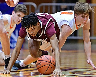 CANTON, OHIO - MARCH 7, 2019: Boardman's Dacone Martin, left, and Green's Shea Simmer crawl for a loose ball during the first half of their OHSAA Tournament game, Thursday night at the Canton Civic Center. DAVID DERMER | THE VINDICATOR