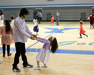 Jose Feliciano dances with his daughter Alexis Feliciano, 6, both of Youngstown, during the Youngstown City School District father-daughter dance at East High School on Friday night. EMILY MATTHEWS   THE VINDICATOR