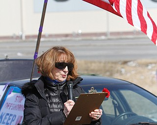 ROBERT K.YOSAY  | THE VINDICATOR..Werner Lange, the guy who held the 43 day vigil outside the plant, is having an outdoor tribute to women workers and a Òprotest against the gross injustice of idling of this plant.Ó..Roxanne Lange reads a statement on International Womens day