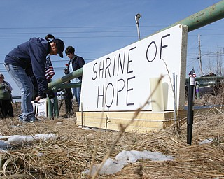 ROBERT K.YOSAY  | THE VINDICATOR..Werner Lange, the guy who held the 43 day vigil outside the plant, is having an outdoor tribute to women workers and a Òprotest against the gross injustice of idling of this plant.Ó..Vickie Raymond plasces a flower and a light for the memorial