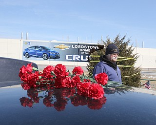 ROBERT K.YOSAY  | THE VINDICATOR..Werner Lange, the guy who held the 43 day vigil outside the plant, is having an outdoor tribute to women workers and a Òprotest against the gross injustice of idling of this plant.Ó..Shrine of Hope erected asSherry Farley , Charmaine Reiter and Vickie Raymond put lights on the sshrine