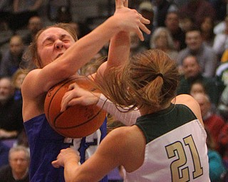 William D. Lewis The Vindicator  Poland's Morgan Kluchar(32) and SvSM'sMaria Dobson(21) battle for the ball.