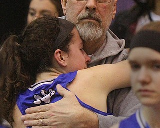 William D. Lewis The Vindicator  Poland's Jackie Grisdale(21) gets a hig from her father Ken Grisdale after Lady Bulldogs lost to Akron SVSM at Barberton 3-8-19. Ken is Poland Boys Basketball coach.