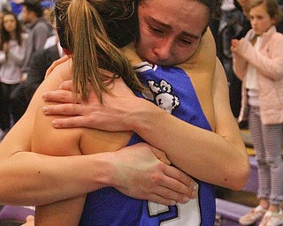 William D. Lewis The Vindicator  Poland's Sarah Bury(2) hugs Jackie Grisdale)21) after loss to Akron SVSM at Barberton 3-8-19.