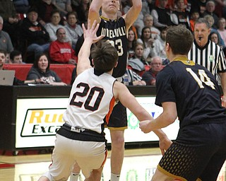 Cole Bunofsky (23) of Lowellville goes up for a shot over Beau Brungard (20) of Springfield during Friday nights district championship game at Struthers High School.  Dustin Livesay  |  The Vindicator  3/8/19  Struthers