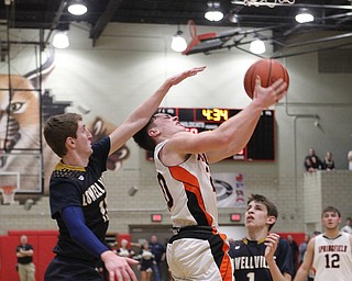 Beau Brungard (20) of Springfield gets hit in the head by Jake Rotz (15) of Lowellville during Friday nights district championship game at Struthers High School.  Dustin Livesay  |  The Vindicator  3/8/19  Struthers