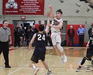 Beau Brungard (20) of Springfield passes the ball over Lowellville's Joe Ballone (24) during Friday nights district championship game at Struthers High School.  Dustin Livesay  |  The Vindicator  3/8/19  Struthers