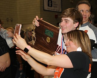 Springfield's Clay Medvec takes a picture with his mom Angie Medvec with the District Championship trophy after they defeated Lowellville at the Struthers Fieldhouse on Friday night.  Dustin Livesay  |  The Vindicator  3/8/19  Struthers