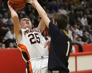 Adam Wharry (25) of Springfield puts up a shot while being closely defended by Lowellville's Micah Mamula Zarlingo (1) during Friday nights district championship game at Struthers High School.  Dustin Livesay  |  The Vindicator  3/8/19  Struthers
