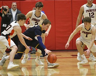 Jake Rotz (middle) of Lowellville fights for a loose ball with Springfield's Beau Brungard (left) and Evan Ohlin (1) during Friday nights district championship game at Struthers High School.  Dustin Livesay  |  The Vindicator  3/8/19  Struthers