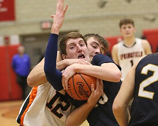 Springfield's Shane Eynon (12) and Lowellvilles Jake Rotz (15) fight for the ball in the fourth quarter of Friday nights district championship game at Struthers High School.  Dustin Livesay  |  The Vindicator  3/8/19  Struthers