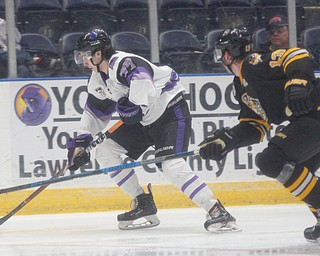 Phantoms' Matthew Barnaby Jr. tries to keep the puck from Gamblers' Xan Gurney during their game at Covelli Centre on Saturday night. EMILY MATTHEWS | THE VINDICATOR