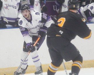 Phantoms' Josh DeLuca looks to pass the puck while Gamblers' Jarod Crespo tries to block him during their game at Covelli Centre on Saturday night. EMILY MATTHEWS | THE VINDICATOR