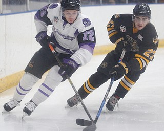 Phantoms' Liam Dennison and Gamblers' Nicholas Zabaneh go after the puck during their game at Covelli Centre on Saturday night. EMILY MATTHEWS | THE VINDICATOR