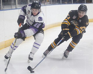 Phantoms' Liam Dennison tries to get the puck from Gamblers' Nicholas Zabaneh during their game at Covelli Centre on Saturday night. EMILY MATTHEWS | THE VINDICATOR