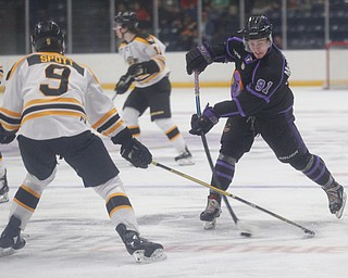 The Phantoms' Connor MacEachern prepares to pass the puck while the Gamblers' Tyler Spott tries to block him during their game in Covelli Centre on Sunday. EMILY MATTHEWS | THE VINDICATOR