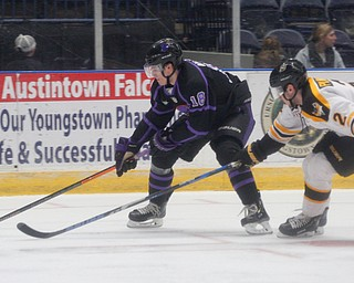 The Phantoms' Jack Malone tries to keep the puck from the Gamblers' Chase Pilawski during their game in Covelli Centre on Sunday. EMILY MATTHEWS | THE VINDICATOR