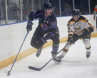 The Phantoms' Brett Murray takes the puck behind the net as he tries to keep it from the Gamblers' Tyler Spott during their game in Covelli Centre on Sunday. EMILY MATTHEWS | THE VINDICATOR