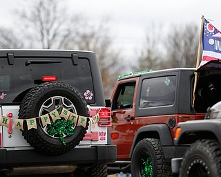Jeeps decked out in St. Patrick's Day decorations drive down Market Street during the Mahoning Valley St. Patrick's Day Parade in Boardman on Sunday afternoon. EMILY MATTHEWS | THE VINDICATOR