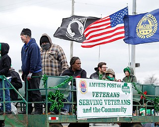 Members of the AMVETS Post 44 ride in the Mahoning Valley St. Patrick's Day Parade in Boardman on Sunday afternoon. EMILY MATTHEWS | THE VINDICATOR