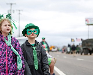 Siblings Nora, 6, and Liam McMasters, 4, watch the Mahoning Valley St. Patrick's Day Parade in Boardman on Sunday afternoon. EMILY MATTHEWS | THE VINDICATOR