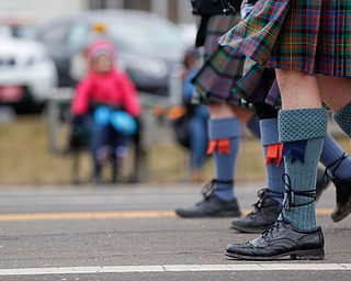 Members of the Macdonald Pipe Band of Pittsburgh march in the Mahoning Valley St. Patrick's Day Parade in Boardman on Sunday afternoon. EMILY MATTHEWS | THE VINDICATOR