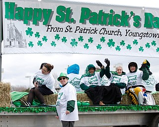 People with St. Patrick Church ride and walk in the Mahoning Valley St. Patrick's Day Parade in Boardman on Sunday afternoon. EMILY MATTHEWS | THE VINDICATOR