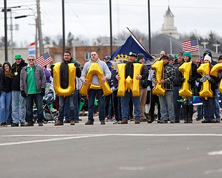 People with the UAW 1112 walk in the Mahoning Valley St. Patrick's Day Parade in Boardman on Sunday afternoon. EMILY MATTHEWS | THE VINDICATOR
