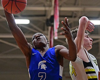 CANTON, OHIO - MARCH 12, 2019: Richmond Heights' Jevontae Jones grabs a rebound away from Bristol's Matt Church during the second half of their game, Tuesday night at the Canton. Richmond Heights won 66-34. DAVID DERMER | THE VINDICATOR